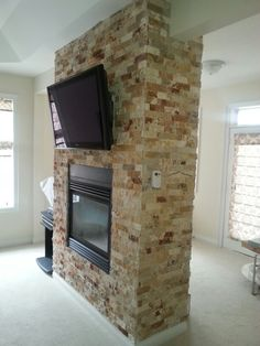 Travertine vaneer stone wrapped around fireplace