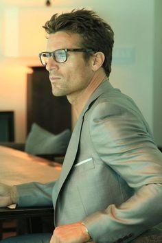 glasses, light gray jacket, white pocket square