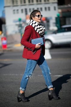 Thassia Naves is seen wearing a red jacket and a bue Chanel bag in the streets of Manhattan during New York Fashion Week Women's Fall/Winter 2016 on...