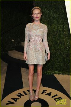 Kate Bosworth is wearing a Giambattista Valli dress, a Rauwolf clutch, Casadei shoes