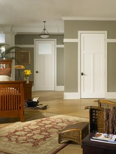 Powder room door inspiration with small rectagular frosted glass on top. Single panel with historic trim detail to match existing doors.