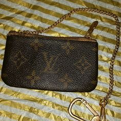 Vintage Purposed Louis Vuitton Keychain Coin Purse This is reposh from PM friend who sells all vintage LV bags and jewelry. I have enjoyed a couple of months but need to sell all I can to give disabled veteran a job. So here goes.... #Vintage Louis Vuitton  #Rare Louis Vuitton  #Louis Vuitton Coin purse holder Trade value higher! Louis Vuitton Bags Clutches & Wristlets