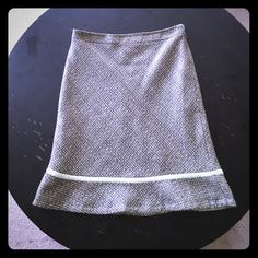 """GAP Natural A-line Tweed Skirt Size 6 Pretty GAP tweed skirt in a Size 6.  Khaki & cream with mint green accents. Velvet ribbon around the bottom creates a flare ruffle hem. Fully lined with hidden side zipper. Laying flat: Waist 15""""  Length 22"""". Only worn twice, in like new condition! I consider reasonable offers! GAP Skirts A-Line or Full"""
