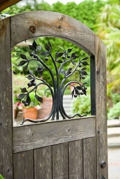 Wood garden gate with decorative tree accent. Pin of the Day 9/7: Fancy schmancy gate