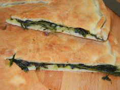Tiella con scarola, olive di Gaeta e alici