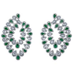 Robert Procop Emerald & Diamond Flexible Spray Hoop Earrings. 18k white gold, set with 7.12 total carats of pear-shaped, Colombian emeralds, as well as 11.53 total carats of pear-shaped and round-cut diamonds.