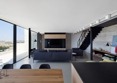 Tel Aviv penthouse apartment renovated using raw materials.