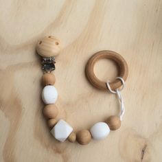 Wood Soother Clip with teething beads by StringforPearls on Etsy