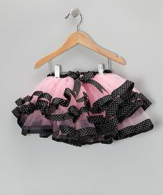 This swishy tutu steals the spotlight with its ribbon trim, fluffy tulle layers and satiny accents. Featuring an elastic waistband, this no-slip skirt lets a ballerina bounce with flounce.100% polyesterHand washImported