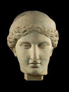 .Head of marble statue of an Olympian goddess, perhaps Demeter or Hera, wearing sphendone; chignon lost from back of head; surface worked over in modern times.Following a fifth century BC model.