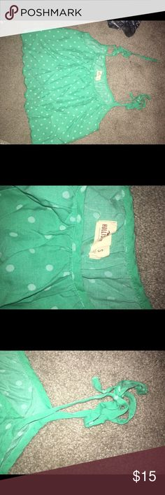 Hollister tank top This is a tank top from Hollister that comes with straps that you tie yourself. No more worrying about if it will fit too loose or tight! The colors are turquoise and a little bit lighter blue for the polka dots. Hollister Tops Tank Tops