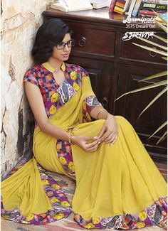 Gorgeous Lemon Yellow Georgette Saree which will add elegance to your look and will make you look striking. It is further amended with Digital Floral Printed, Abstract & Graphical Printed Lace carrying Pashmina Geometrical Printed Blouse.