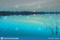 Photo about Natural gravel lake. Photographed at sunset. Slovakia. Image of district, lake, forest - 214471827 Lake Forest, Sunset, Country, Natural, Image, Rural Area, Sunsets, Country Music, Nature