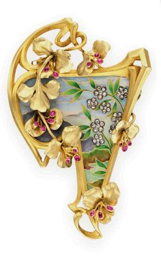 AN ART NOUVEAU ENAMEL, GOLD AND MULTI-GEM BROOCH   Designed as a triangular multi-colored enamel plaque depicting a stylized landscape, decorated with rose-cut diamond florets, within a sculpted 18k gold foliate surround, enhanced by cabochon ruby buds, mounted in 18k gold, circa 1905, with French assay mark and maker's mark (indistinct)