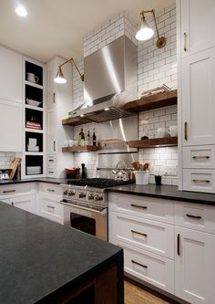 Similar to what I want except black cabs with white countertops. Brass pulls, stainless appliances, subway tile, rustic wood accents.