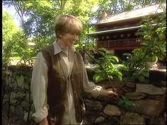 Martha Stewart prunes a dwarf apple tree on a Belgian Fence in order to explain the espalier technique.
