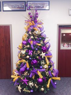 Stepped up my decorating skills this year!  Purple and gold Christmas tree!