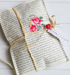 A gorgeous way to uniquely wrap a gift for someone special. Pages from an old book are stitched together and tied with raffia. The true finishing pieces though are rubber stamps, to add a vintage effect and a small piece of fabric carefully cut and glued on top. A button of your choice and a handmade tag...and voila! Your own personal gift wrapped present.
