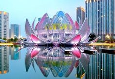 Spectacular Lotus Building and People's Park Dramatically Rises From the Waters of Wujin