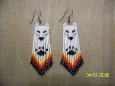 These Beautiful White Wolf earrings are 3 long including ear wire. And are made of glass delica beads and bugle beads.    This patterns comes