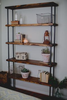 bookshelf to separate the living room from the dining space- visually separates the two spaces without losing the line of sight Home Living Room, Interior Design Living Room, Living Room Decor, Dining Room, Pipe Bookshelf, Bookshelves, Pipe Furniture, Wooden Shelves, Home Projects