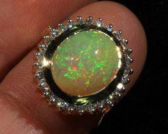 beautiful 14kt welo opal cab ringbrilliant5/5pinfire
