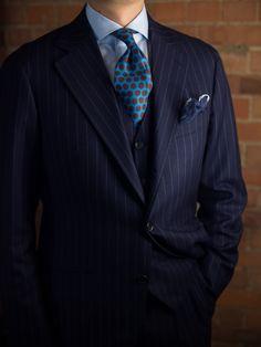 Three piece navy pinstripe, dot tie, spread collar