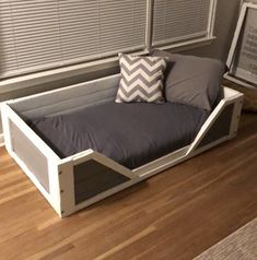 "We adopted a dog from the Humane Society a month ago. Before we even got a dog my husband made the rule ""no dogs on the bed."" So I knew I had to make her the coolest bed… Dog Bed Frame, Wood Dog Bed, Pallet Dog Beds, Diy Dog Bed, Rustic Dog Beds, Cute Dog Beds, Dog Beds For Small Dogs, Unique Dog Beds, Large Dogs"
