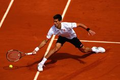 Novak Djokovic of Serbia plays a forehand in his Men's Singles match against Thanasi Kokkinakis of Australia on day seven of the 2015 French Open at Roland Garros on May 30, 2015 in Paris, France.