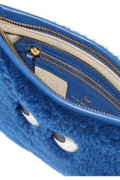 Blue shearling and leather  Zip fastening along top Designer color: Blueberry Imported