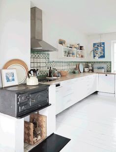 Home with touches of green and a beautiful old stovetop - via cocolapinedesign.com
