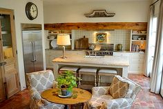 a kitchen that's a cozy room! love it.