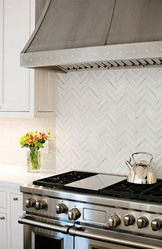 Chevron tile backsplash in kitchen. Gimme.