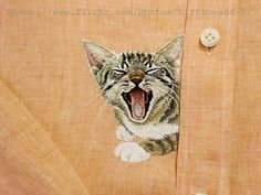 hand embroidered yawning cat in the chest of the by ShopGoGo5