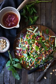 An incredible recipe for Vietnamese Vermicelli Salad w/ Sweet Chili Vinaigrette & Roasted peanuts - bursting with flavor and healthy and light!   www.feastingathome.com