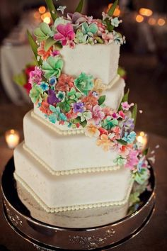 Beautiful and colorful cake decor.  This is a lovely cake, however the filigree dates it immediately.  Minus the filigree and you have a beautiful timeless cake.