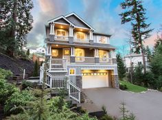 This modern 3-story craftsman is truly at home surrounded by evergreen trees in Washington State.