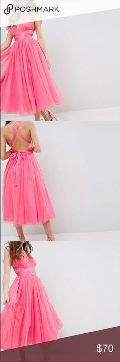 ASOS pink tulle party dress Asos pink tulle party dress. Never worn tags are still on! Looks fun and beautiful for special occasion or prom! Lined tulle top and skirt with pink satin ribbon ties. Asos Dresses