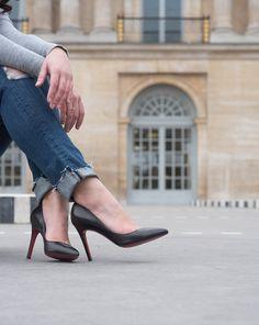 Christian Louboutin Pigalle pumps and Paige Denim Hoxton jeans at the Palais Royal in Paris