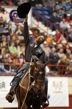 Patrick Dove/Standard-Times  Cory Soloman, of Prairie View, Texas, tips his hat skyward after finishing his run in the tie-down competition at the 80th San Angelo Stock Show & Rodeo Finals on Saturday afternoon at the Foster Communications Coliseum. Soloman won the competition with an average time of 35.7 seconds.