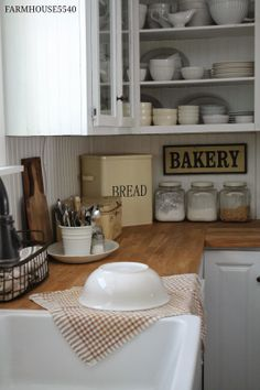 Open faced sink, white cabinets, will do concrete stained foe wood countertop but not panel look backsplash. This is so close to perfection. - Home Decor Pin Kitchen Redo, New Kitchen, Vintage Kitchen, Kitchen Remodel, Kitchen Dining, Kitchen Ideas, Kitchen Corner, Kitchen Signs, Kitchen Bars