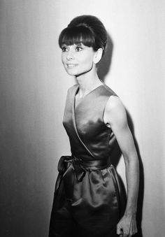 "The actress Audrey Hepburn photographed at the Savoy Hotel in London (England), during a press reception for some of the stars of ""My Fair Lady"", on January 19, 1965.Audrey was wearing:Cocktail ensemble: Givenchy (of emerald green shantung, sleeveless dress in the tunic style, with V-neckline emphasizing the crossed detail, softly gathered at the waist, featuring a satin ribbon in the same color, length above the knees, and skirt in a straight line, with the length just below the knees…"