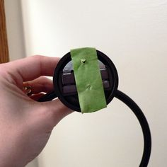 Punch through on the painters tape the location of the screws, then place on the wall so tape stays