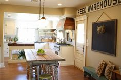 Cute kitchen. Love the hidden appliances!! Fridge is my dream! list of everything. Wall color Windsor Greige by Sherwin Williams