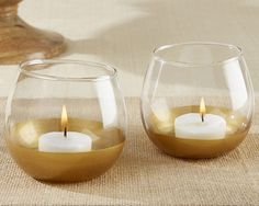Gold Dipped Glass Votive Holder (Set of 4). Casting a golden glow on all who behold it, our Gold Dipped Glass Votive holders are the perfect way to add a touch of light and warmth to your wedding, birthday party, dinner party, or other special occasion. Perfect for a vineyard themed wedding or your wine tasting party, placing these gold-dipped votives on tables will create an atmosphere your guests will love. After the party's over, hand these wine glass shaped votives out as the perfect...