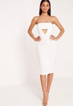 We've got a major girl crush on this figure flattering midi dress in a classic bandeau style! In a dreamy white shade and with cut out detailing to the front for a sexy finish, this crepe dress is on seriously hot piece! Grab your fave heel...