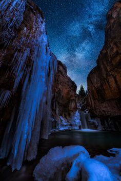A beautiful frozen waterfall beneath a blanket of stars - Lime Creek Falls San Juan National Forest Colorado [1068x1600] Photo by Matt Payne