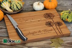 Personalized cutting board for your mom aka your favorite chef! Personalized/Engraved Cutting Board with Dandelion by Bloxstyle, $54.00