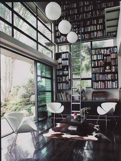 another home library because i am in love with the idea. i could do without the cow rug though.
