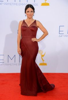 Actress Julia Louis-Dreyfus arrives at the Annual Primetime Emmy Awards at Nokia Theatre L. Live on September 2012 in Los Angeles, California. (Photo by Frazer Harrison/Getty Images) Best Celebrity Dresses, Celebrity Style, Marsala Gown, Julia Louis Dreyfus, Mermaid Gown, Celebs, Celebrities, Feminine Style, Nice Dresses
